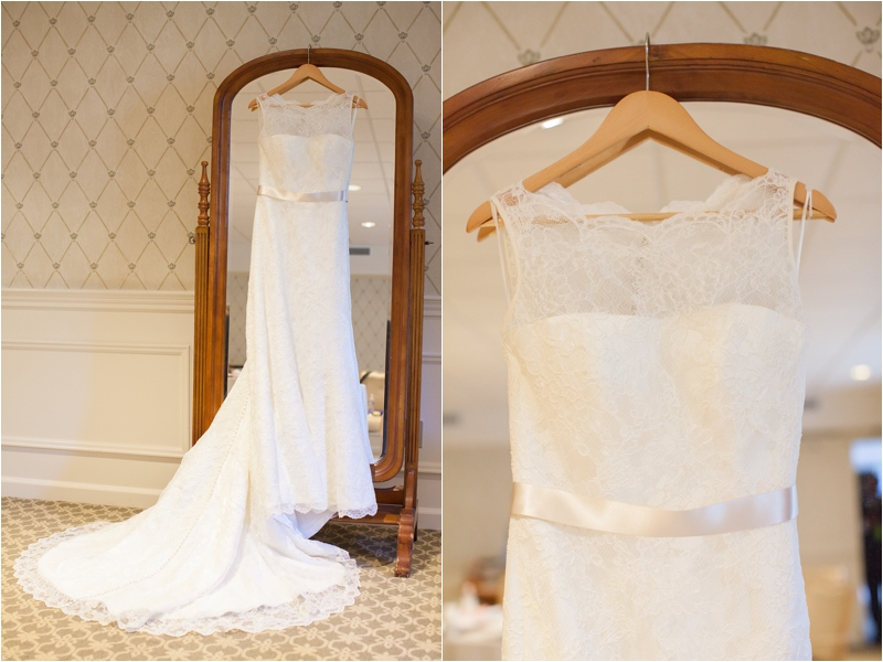bridal dress with long lacey train ready for seaside bride