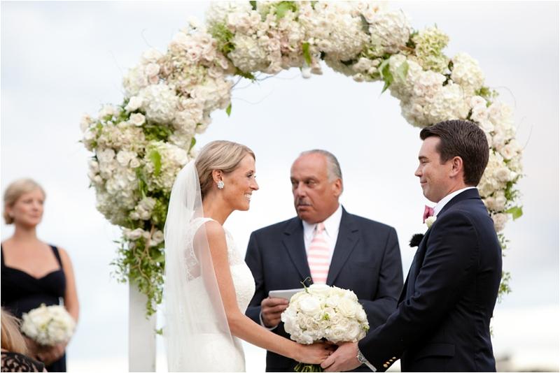 white floral arbor at wedding on massachusetts coast