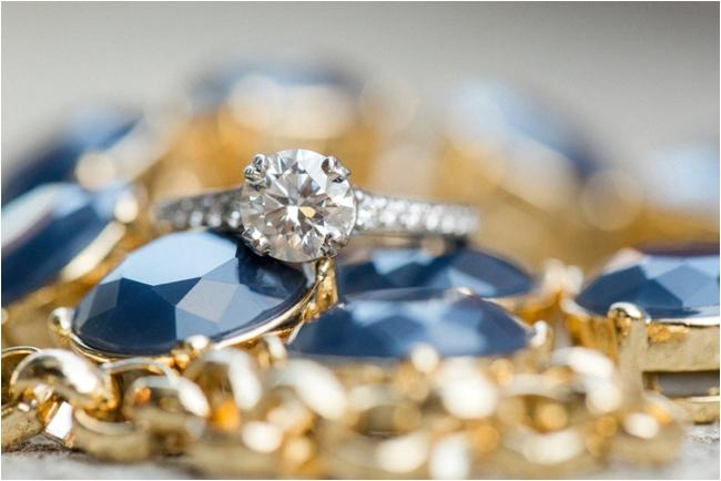 Diamond engagement ring photographed by Deborah Zoe Photography.