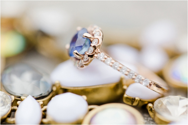 Rose gold and blue sapphire engagement ring photographed by Deborah Zoe Photography.