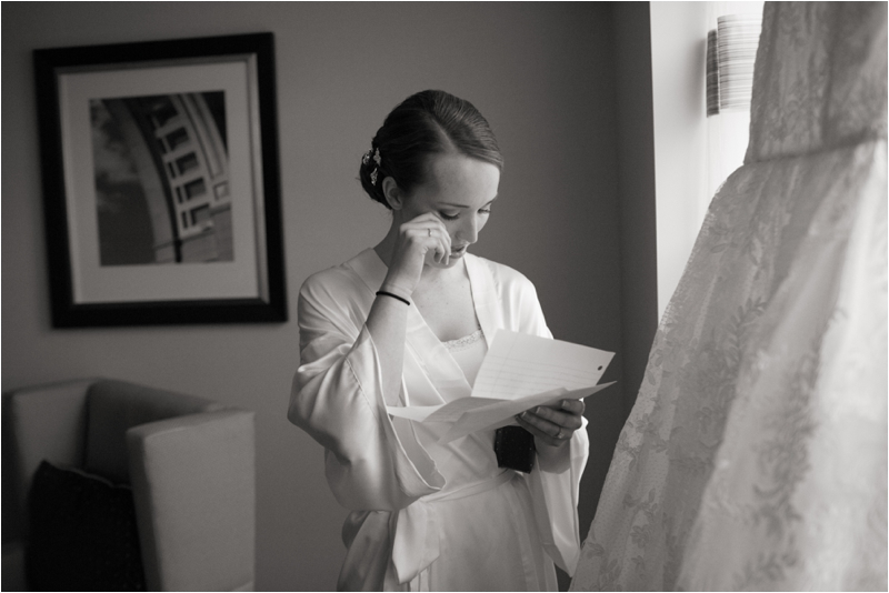 Bride reads note from Groom before her winter wedding