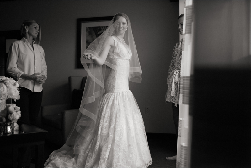 Bride gets into dress before her L'Andana Grill Winter Wedding