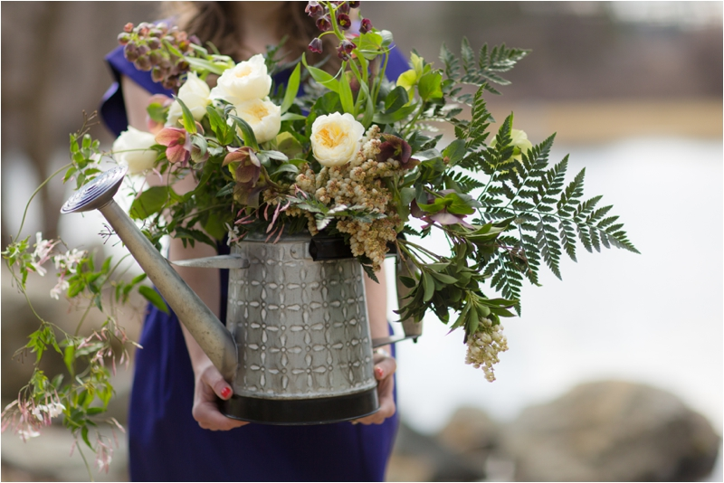 Floral bouquet in a watering can.