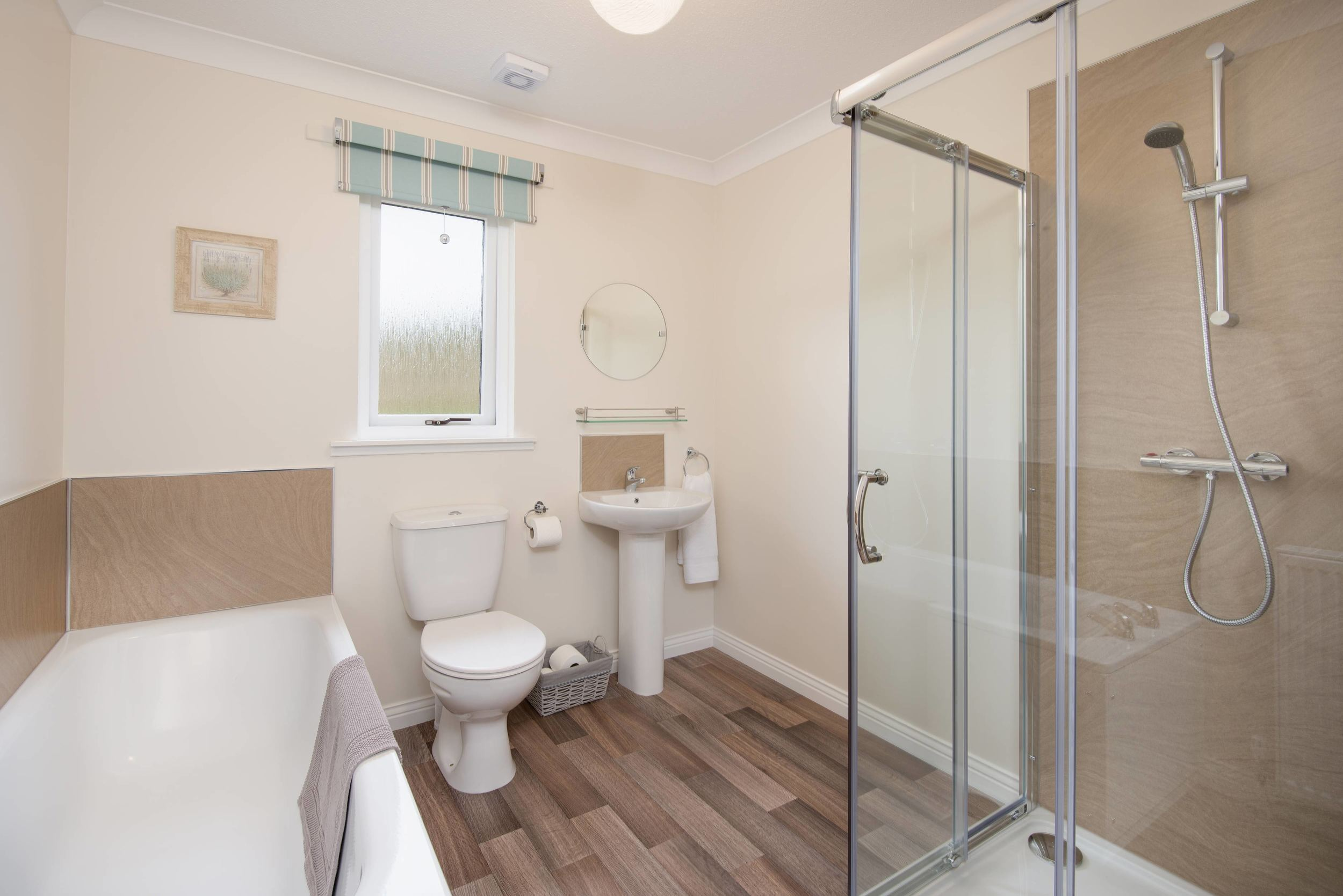 The bathroom is large, modern and provides a separate bath and shower