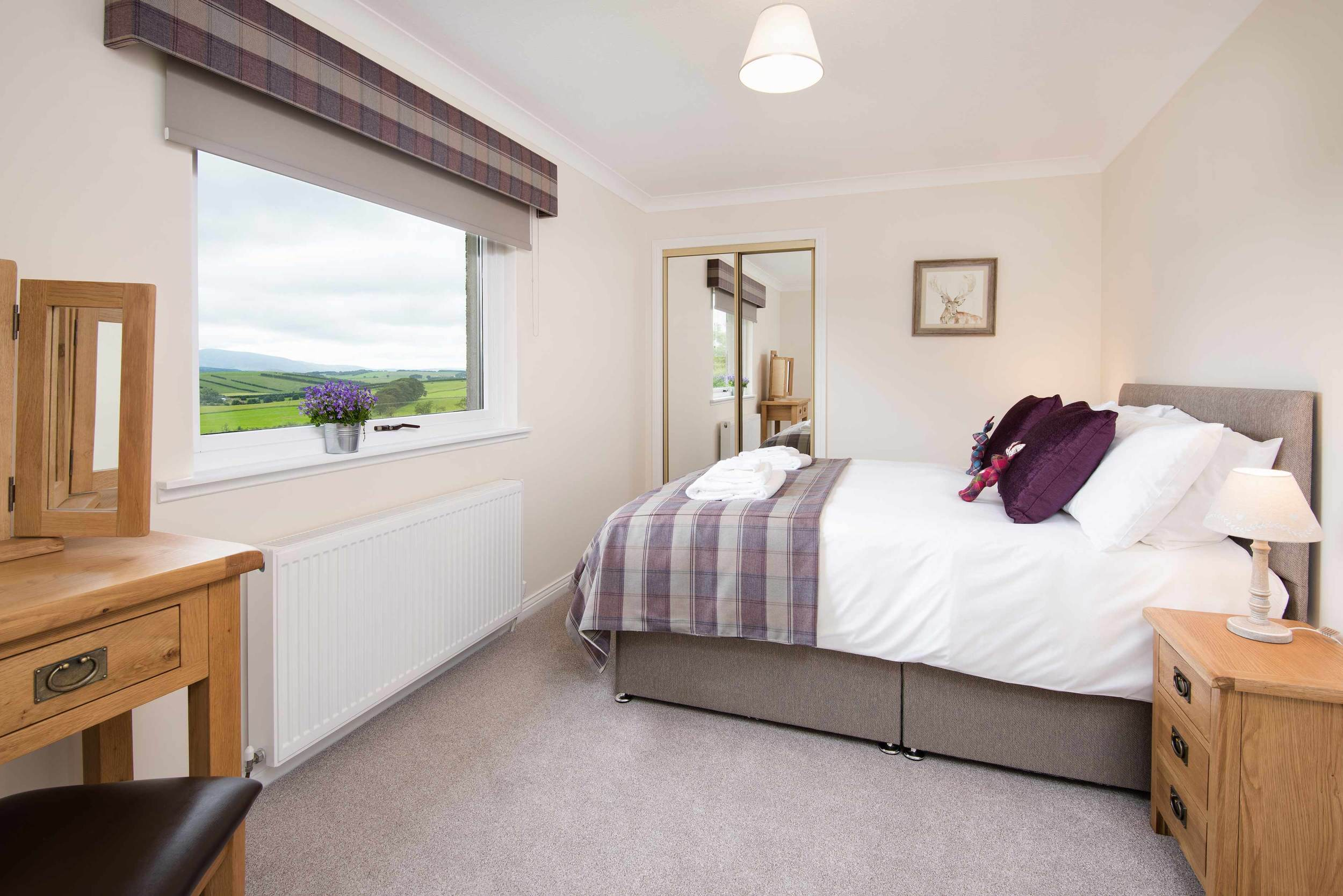Comfortably sleeping four people, the cottage features a large double bedroom with a king size bed and a twin bedroom. A full size fold up bed is available for use in the double bedroom when required.