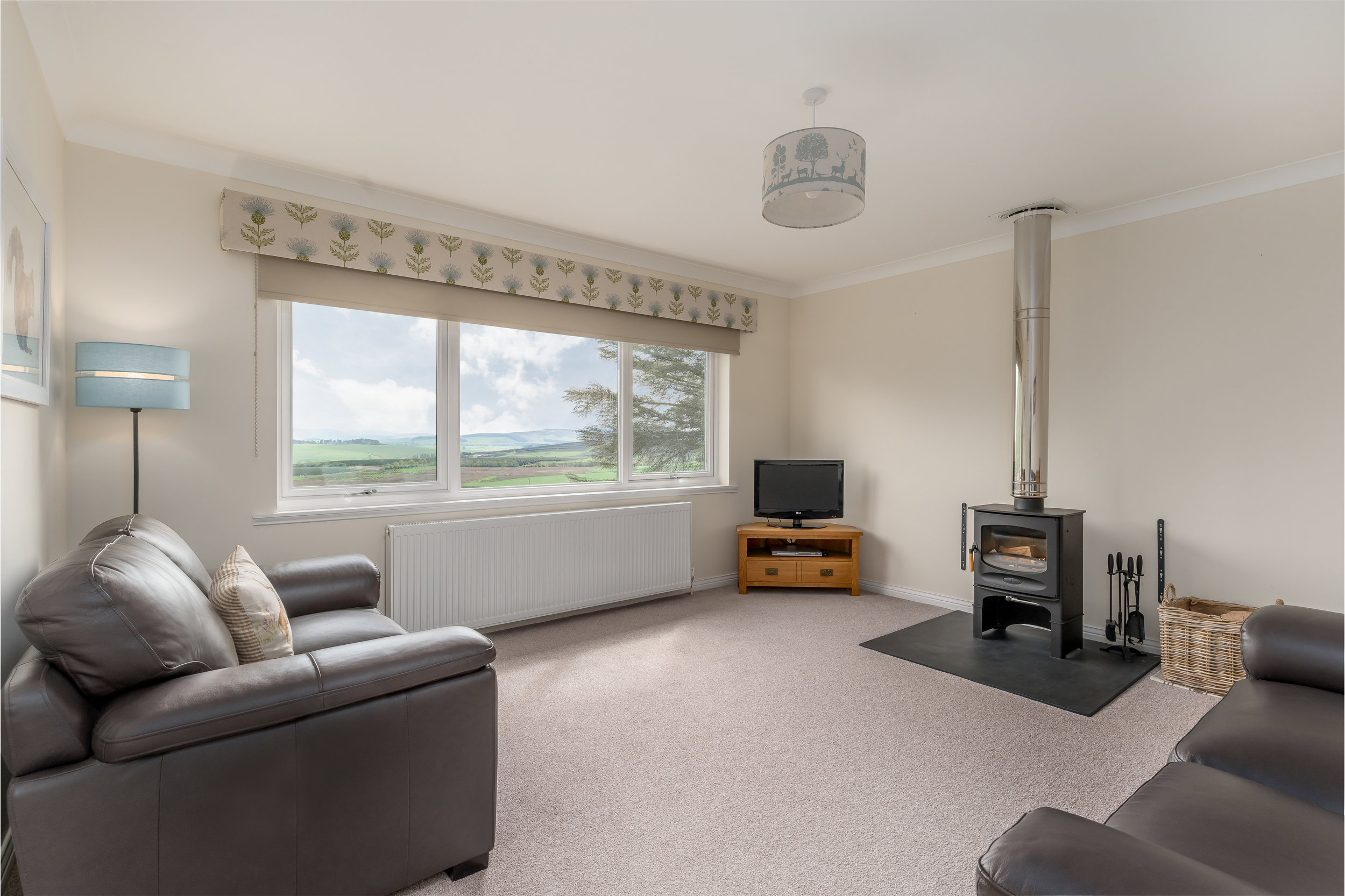 Look through the large living room window and enjoy a simply stunning view. Look inside and rest your gaze on the wood log burner, a selection of books, DVD's and games for all to enjoy.