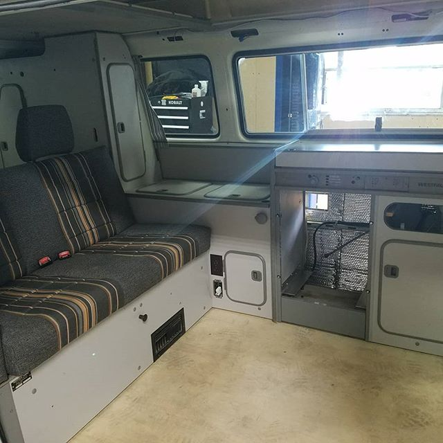 Cabinets, sub floor and some carpet is in! #westylife #vanlife #vanagonlife