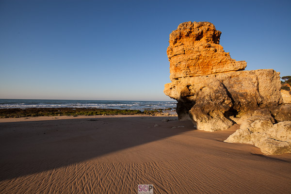 rocks on the beach in low sun portugal