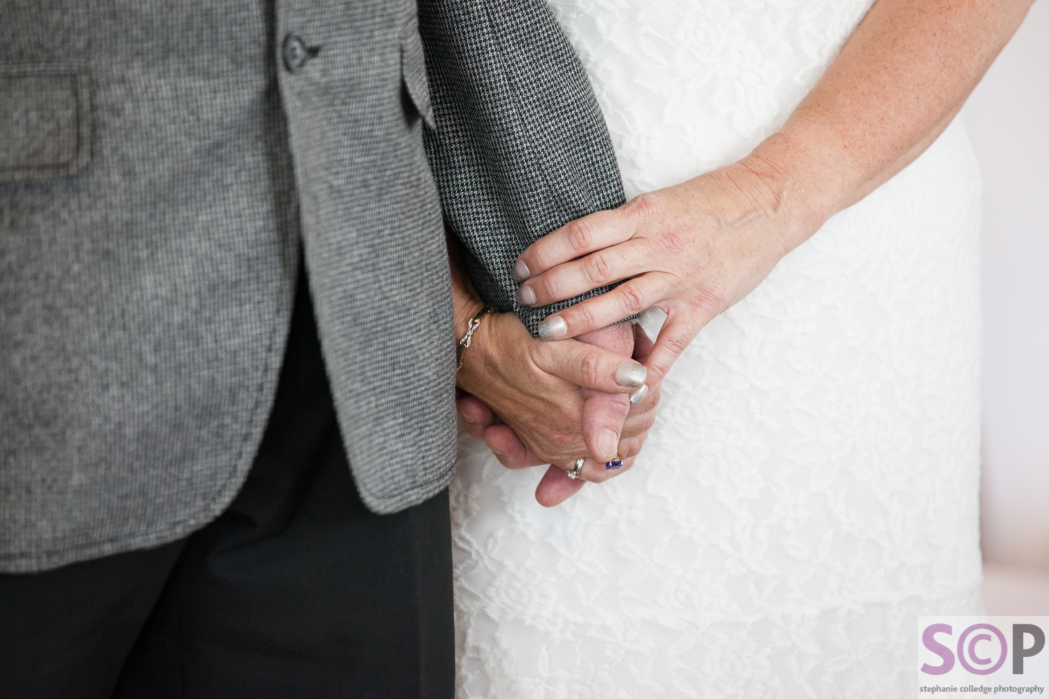 bride and groom holding hands during service