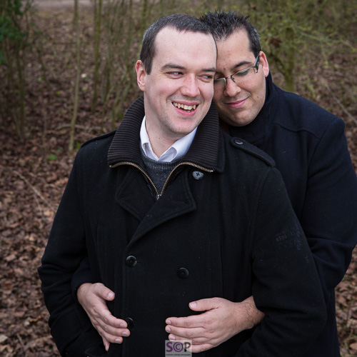 same sex couple embrace laughing