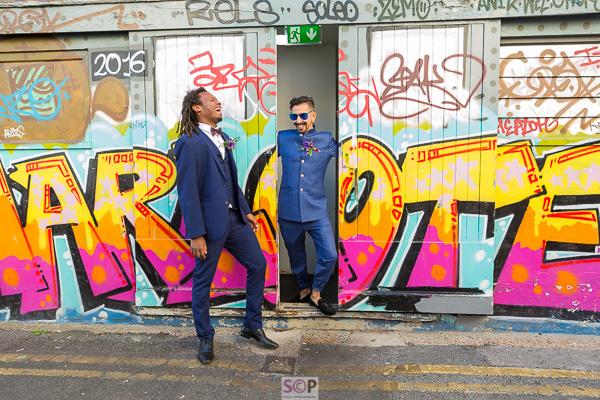 same sex couple with graffiti in brighton