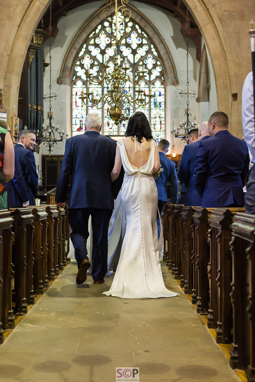 bride and father walking up aisle at St Marks Church Bilton Rugby