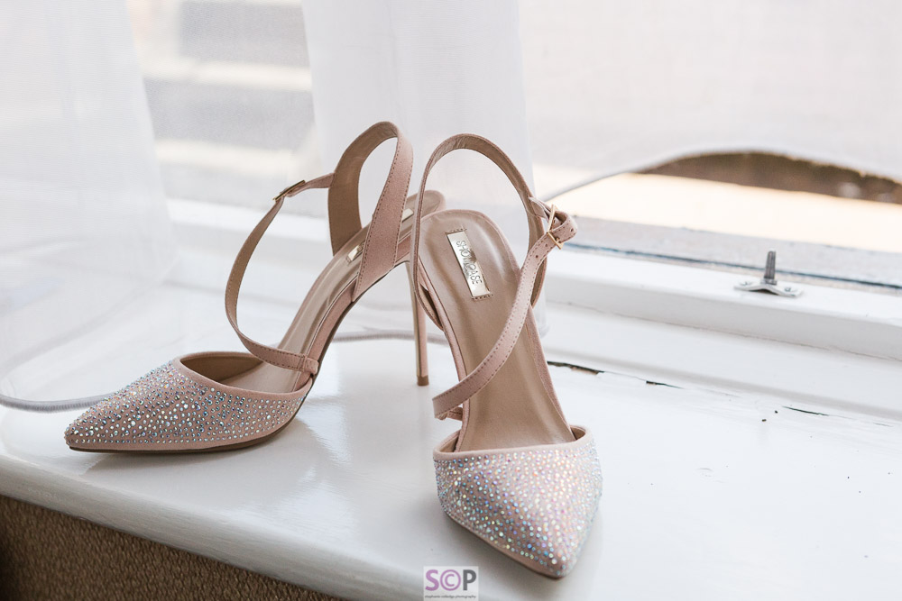 pink diamond shoes on a window sill