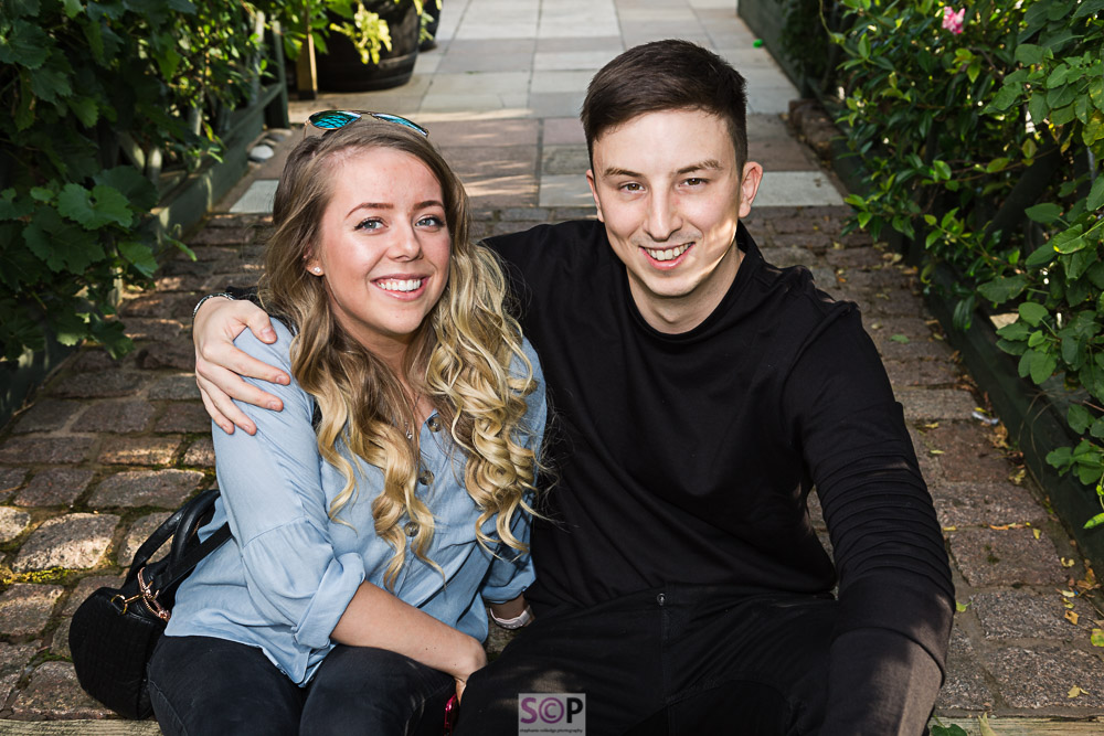 Couple seated in arbour at garden party