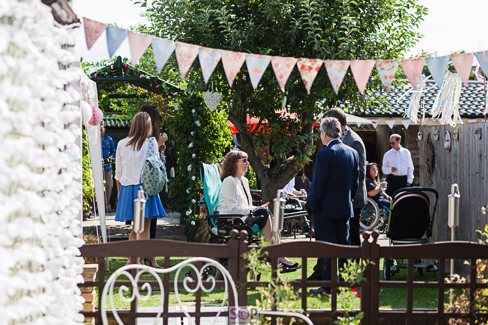 Documentary outdoor party image in garden with bunting