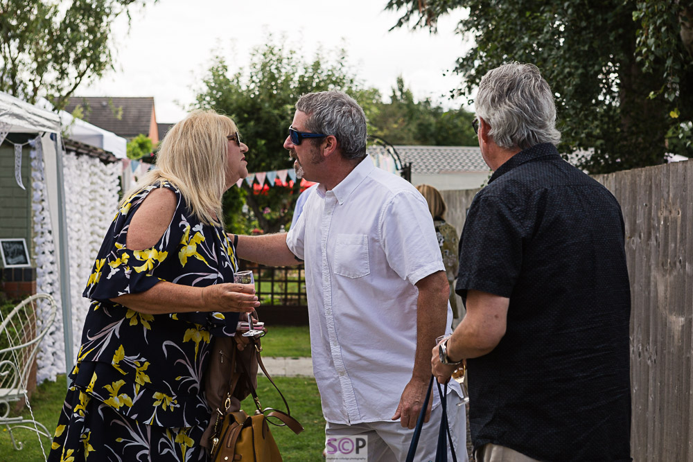 Greeting guests at garden party