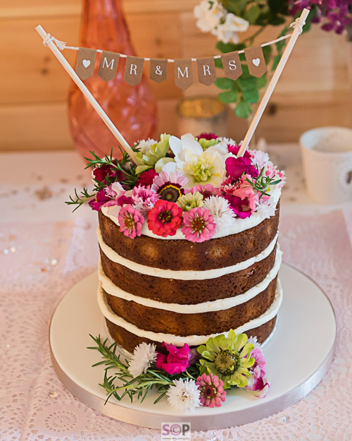 Wedding cake with natural flowers in pink and white