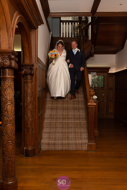 bride and brides father on the stairs at pendrell hall