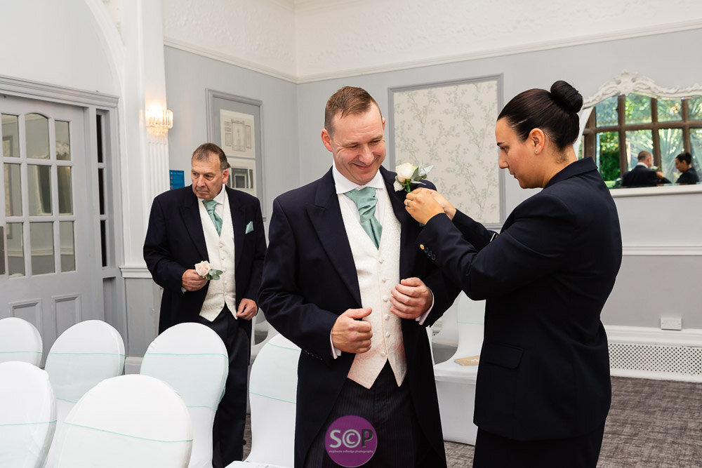 groom in the ceremony room at the iliffe, coventry