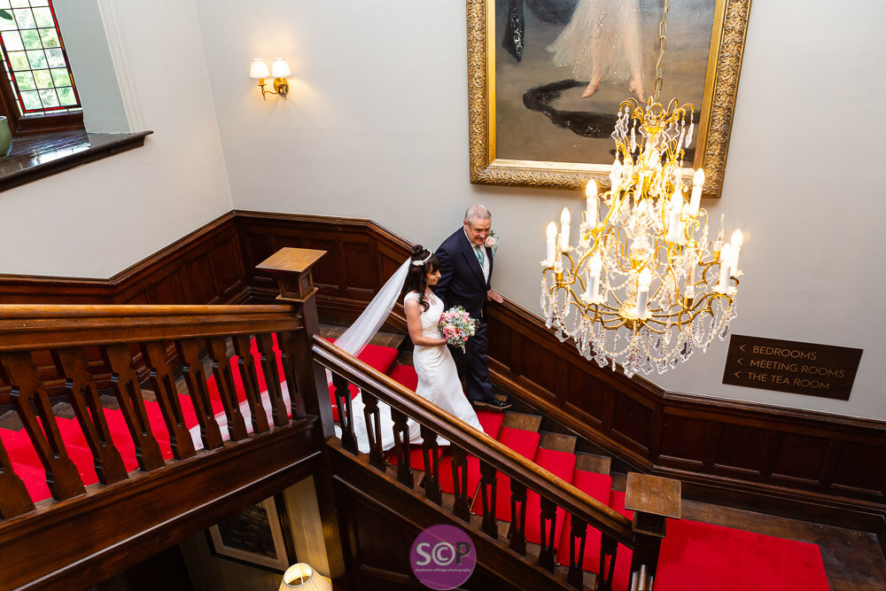 bride on the stairs at the iliffe, coventry