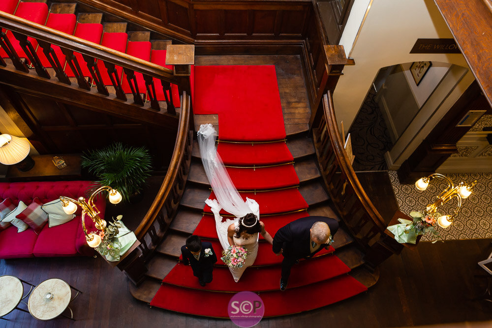 bride decends the stairs at the iliffe, coventry