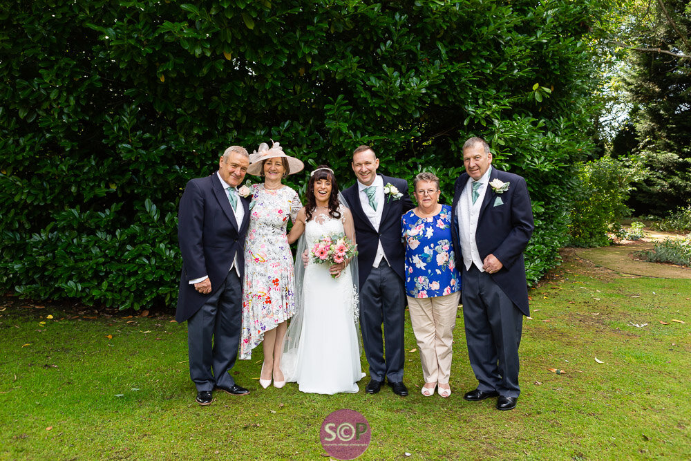 family group in the grounds at the iliffe, coventry