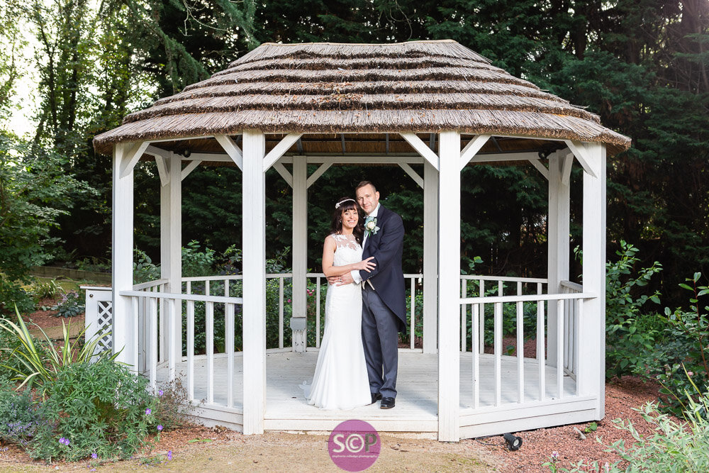 bride and groom in the wedding pavilion at the iliffe, coventry