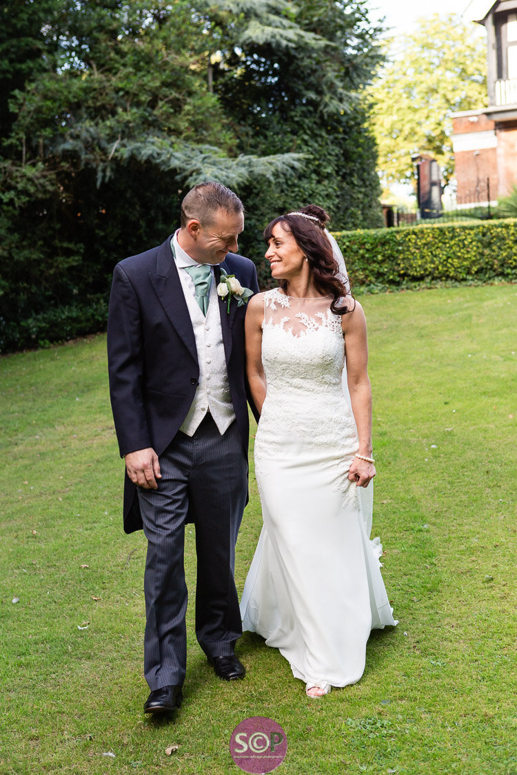 bride and groom walking in the grounds of the iliffe in coventry