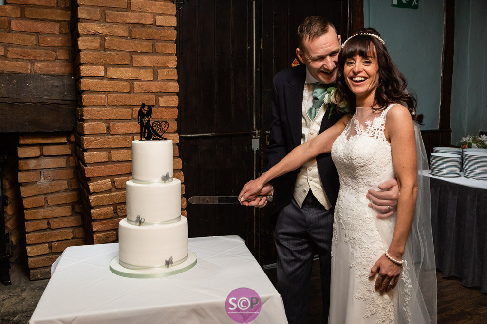 bride and groom cutting the cake at the iliffe coventry evening reception