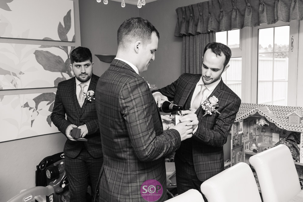 groom and groomsmen drinking before the ceremony