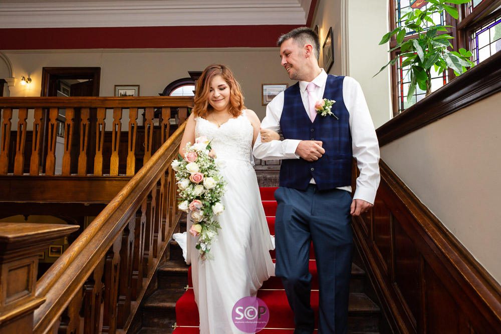 bride and her brother on the stairs at laura ashley hotels the iliffe