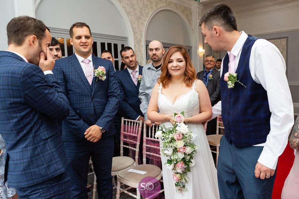 emotional groom sees his bride