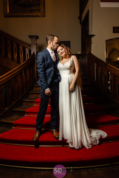 bride and groom on the stairs at the iliffe in coventry