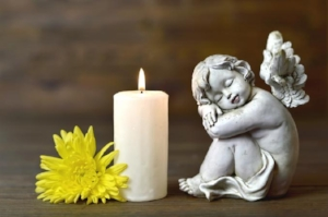 211238-677x450-Angel-candle-and-flower.jpg