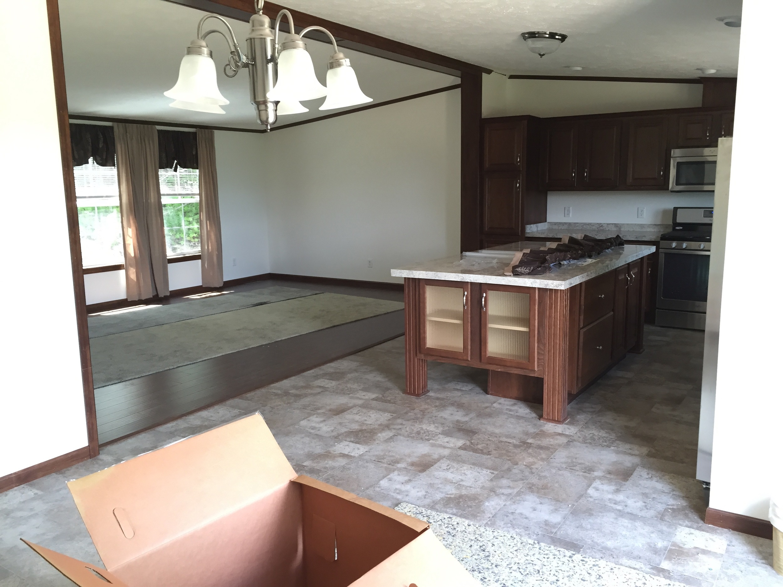 BEFORE: The dining room, living room and kitchen of our manufactured home.