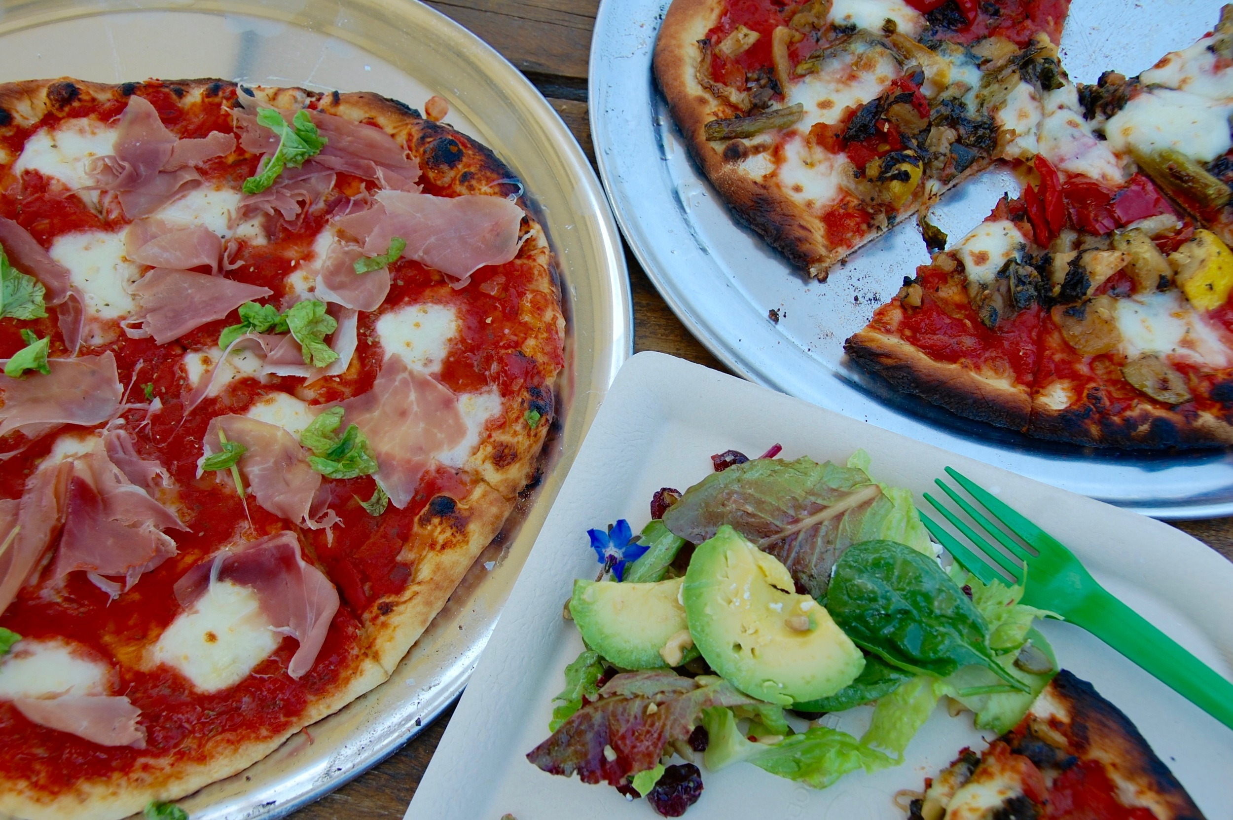 Lunch of Champions: Prosciutto pizza, salad with avocado, vegetarian pizza
