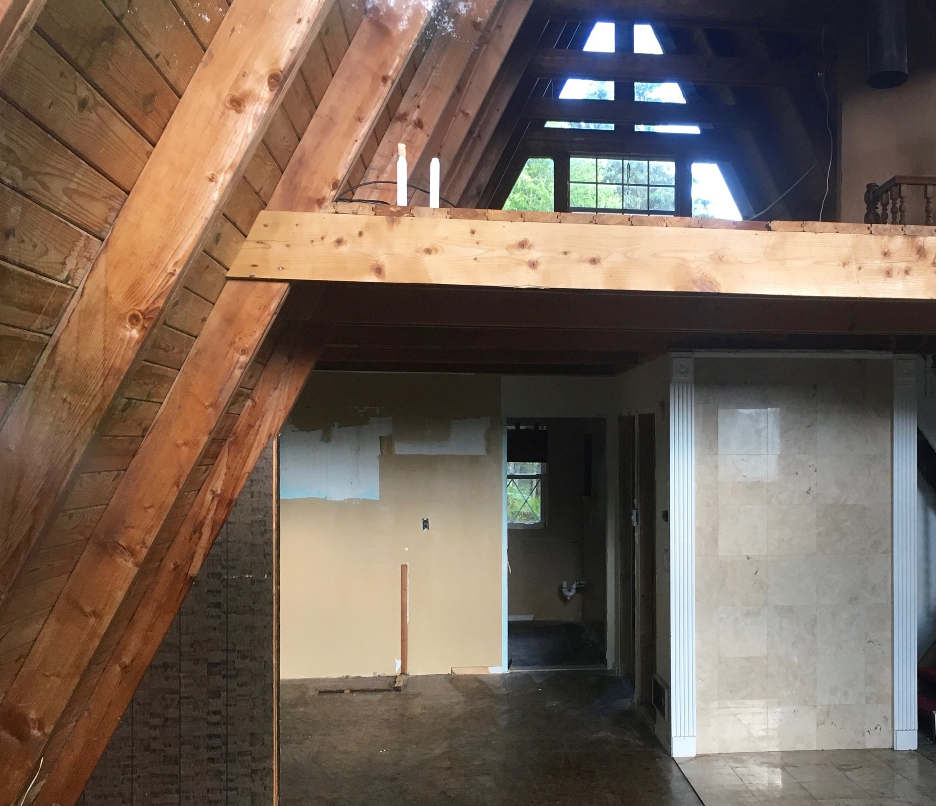 Interior of A-frame house, gutted