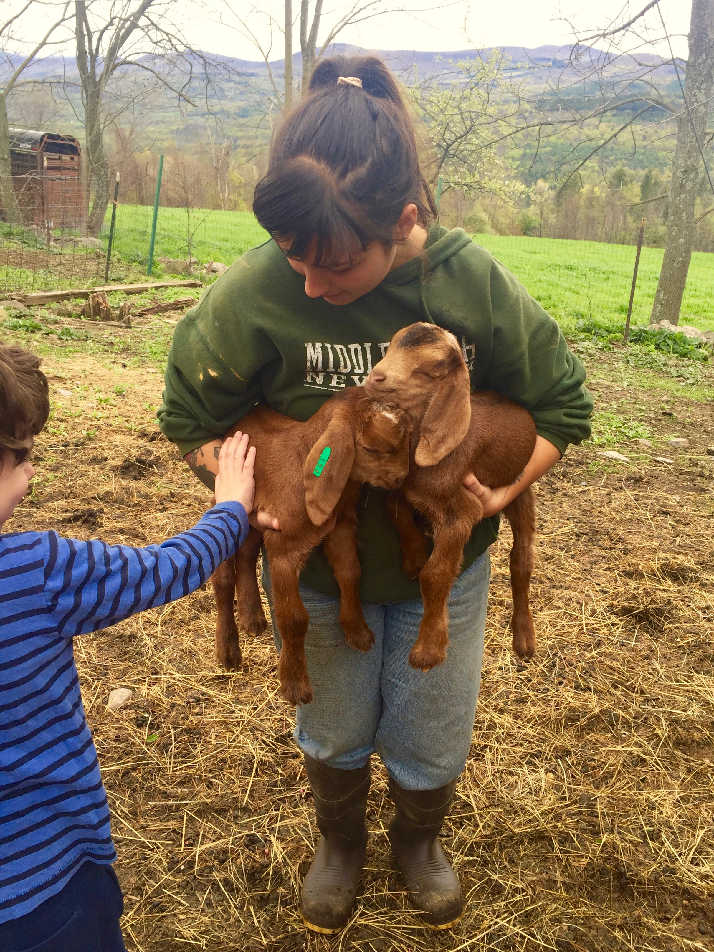 Oona offered Archer a goat to hold in his arms, but petting a goat was enough for him.