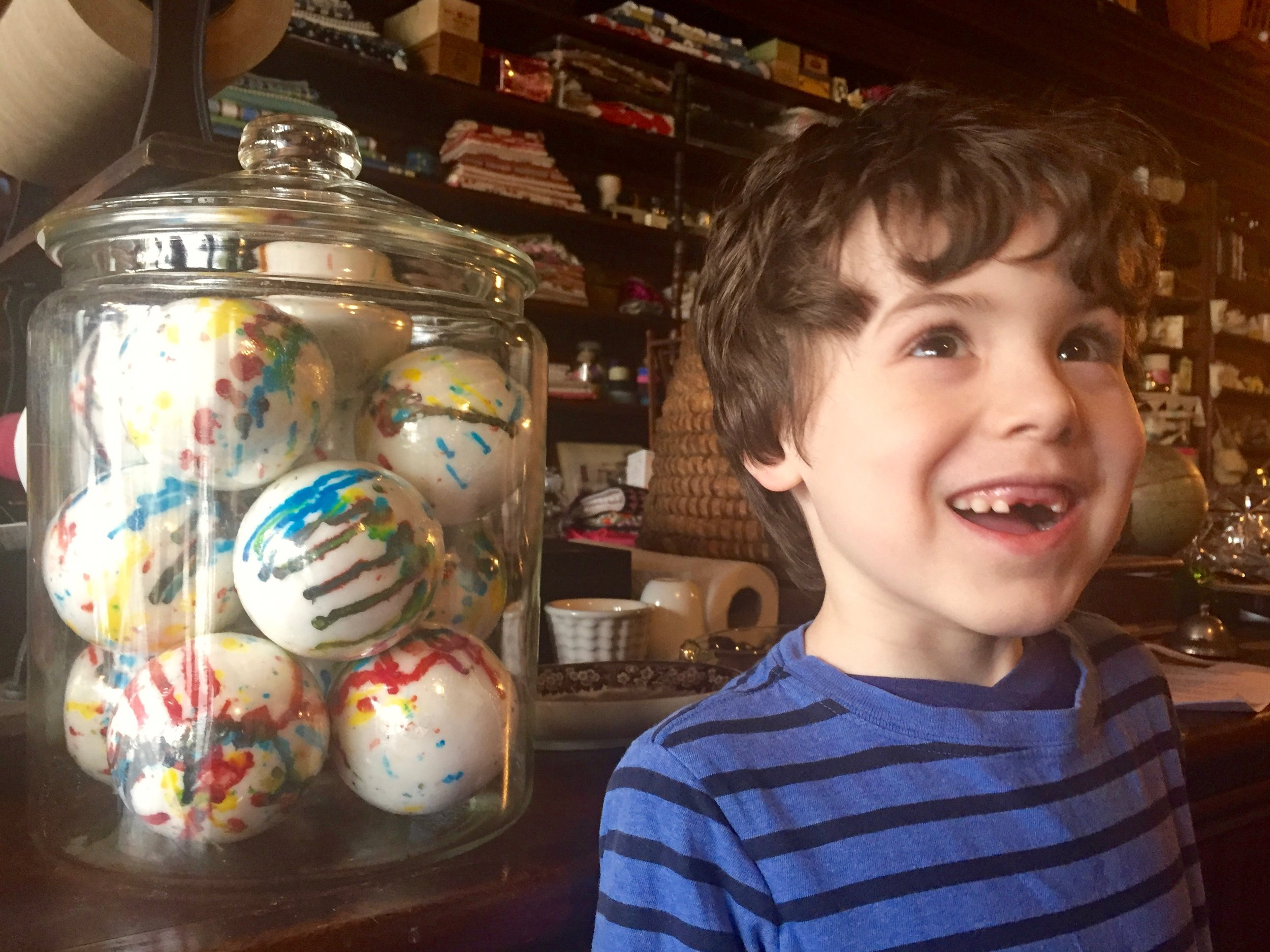 """Jawbreakers are the perfect treat if you aren't too attached to your teeth. Ha! Actually, Archer lost his teeth a couple of weeks ago and is just standing next to the jar for scale. In his words, the jawbreakers are """"ginormous."""""""