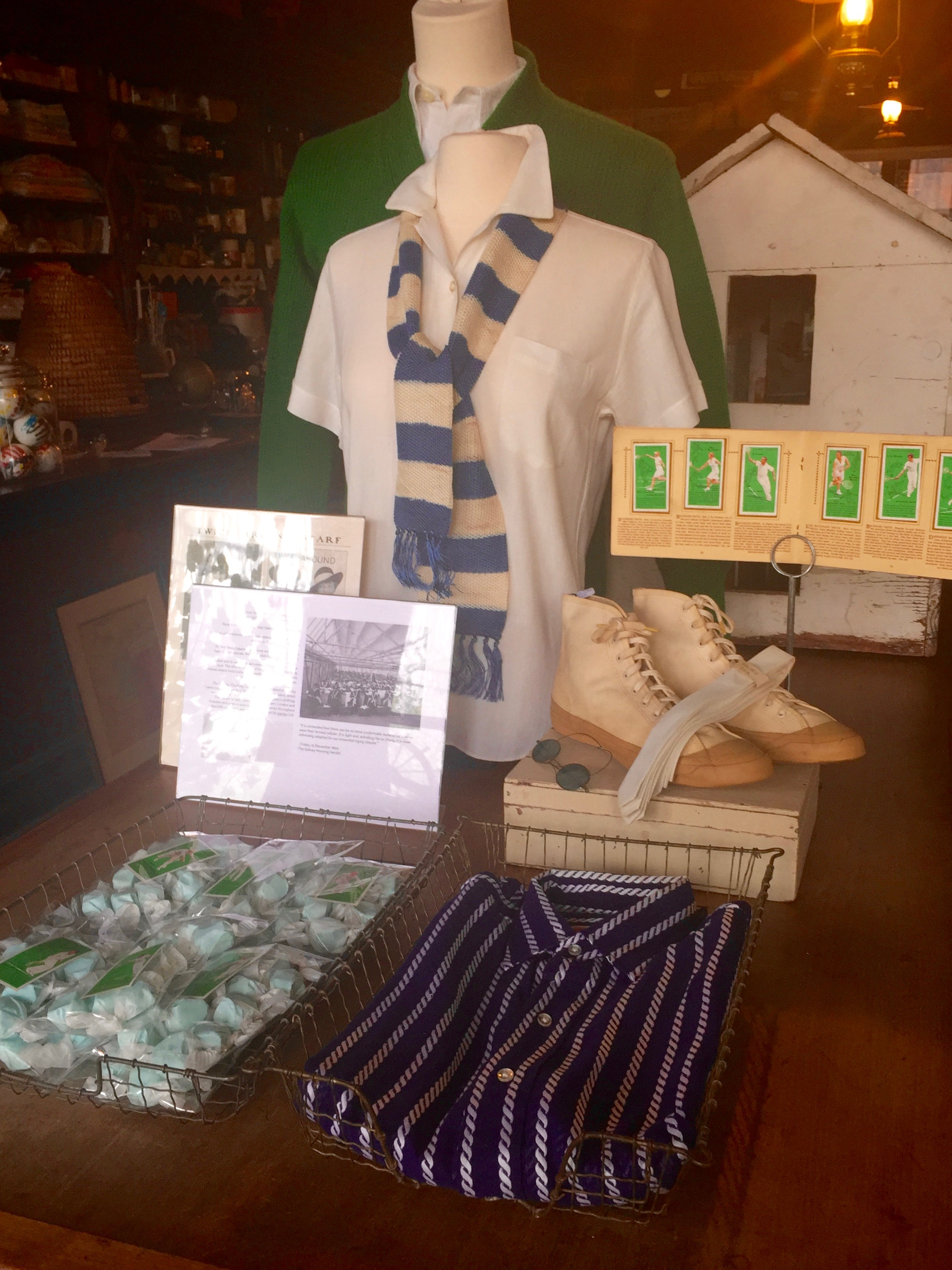 """IU Tripp's front table display combines candy, antiques, and some mint-condition vintage clothing, a.k.a. """"deadstock,"""" a term for merchandise that was never sold or used."""