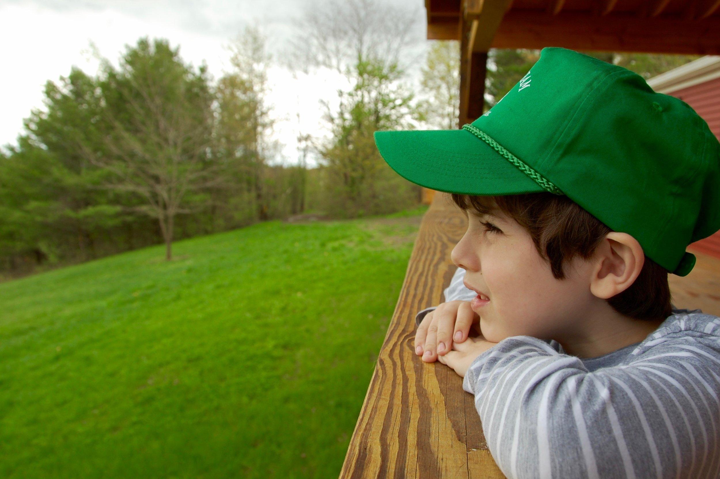 green grass and green cap