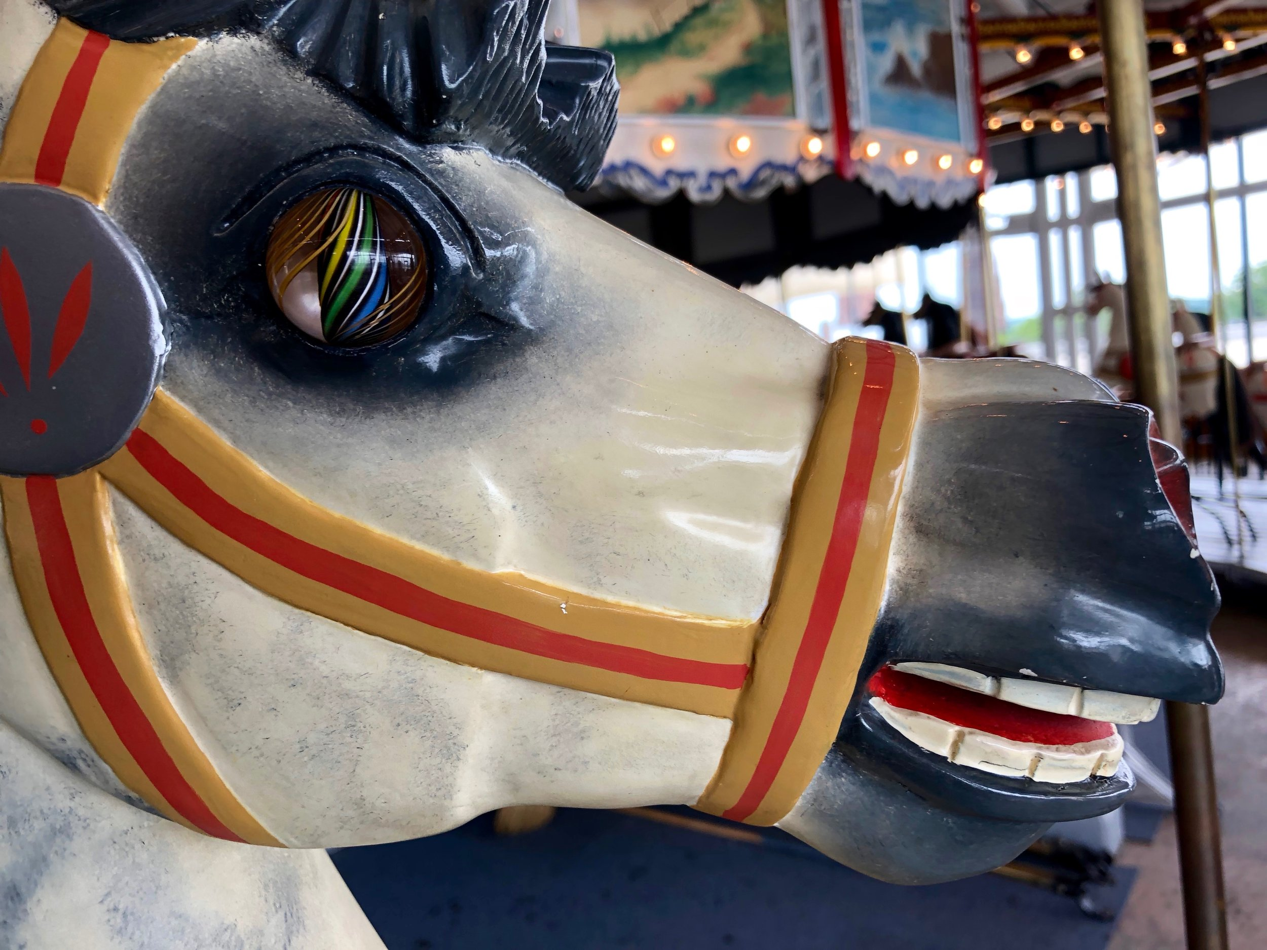 Marble-eyed carousel horse