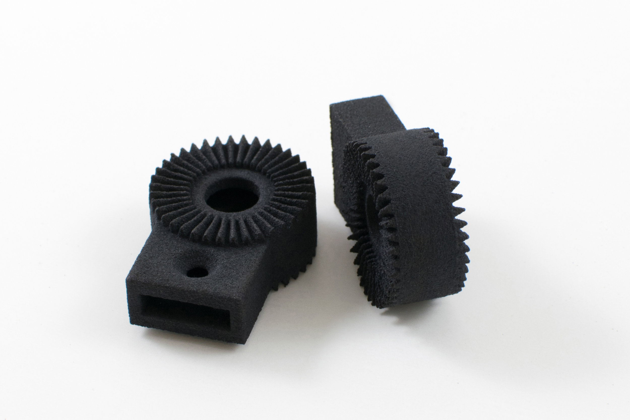 """Low-Cost Solutions to Traditional Manufacturing - Every player in manufacturing has winced at the high-priced """"setup costs"""" and vast """"minimum order quantites"""" associated with bringing a product to life. Additive manufacturing needs no tooling, requires no setup, and demands no quantity. Auxetic has the know-how to keep your costs low and your designs smart by providing the right manufacturing consultation (DFAM) for every request."""