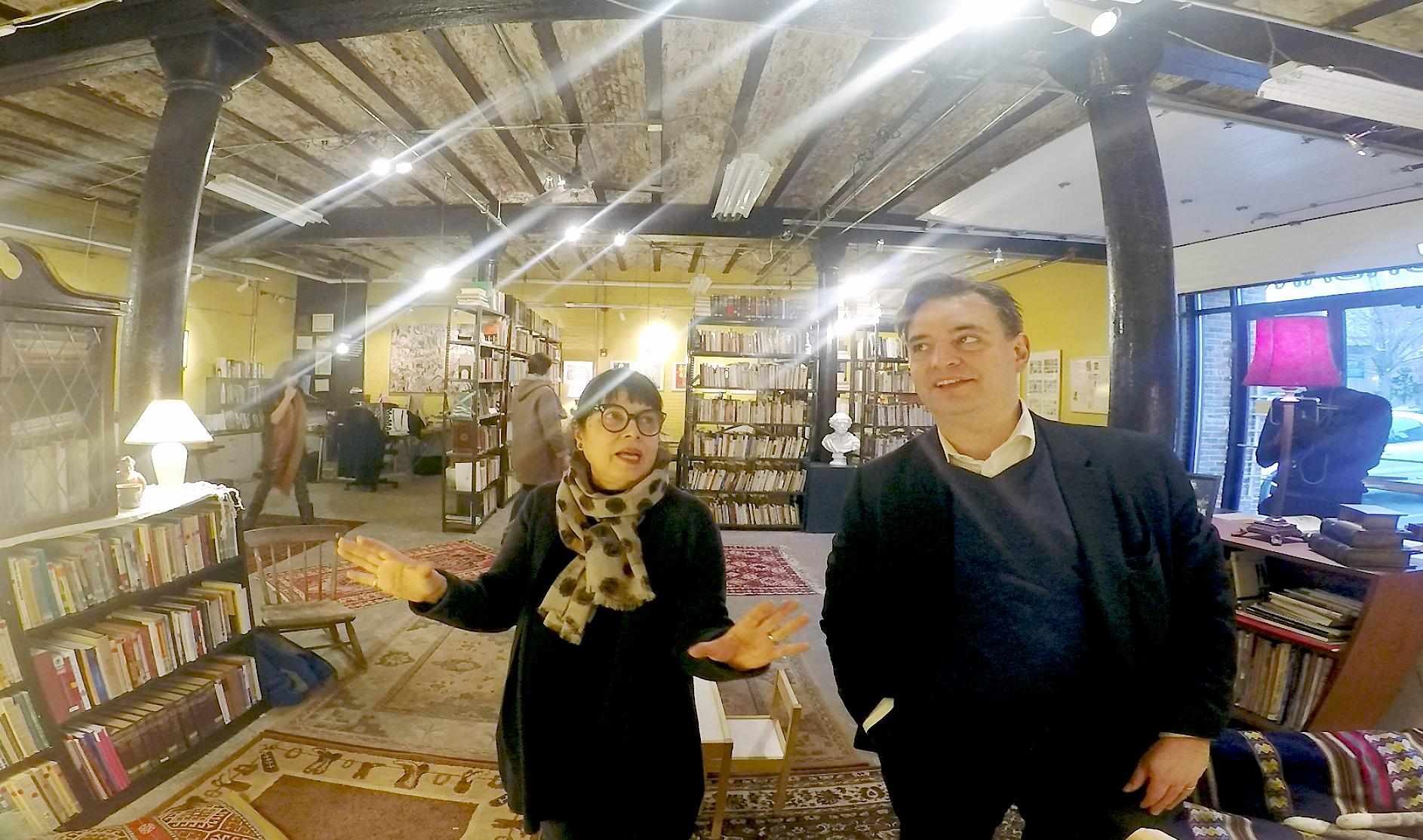 Stella and Pablo view the walls of Librería Donceles.