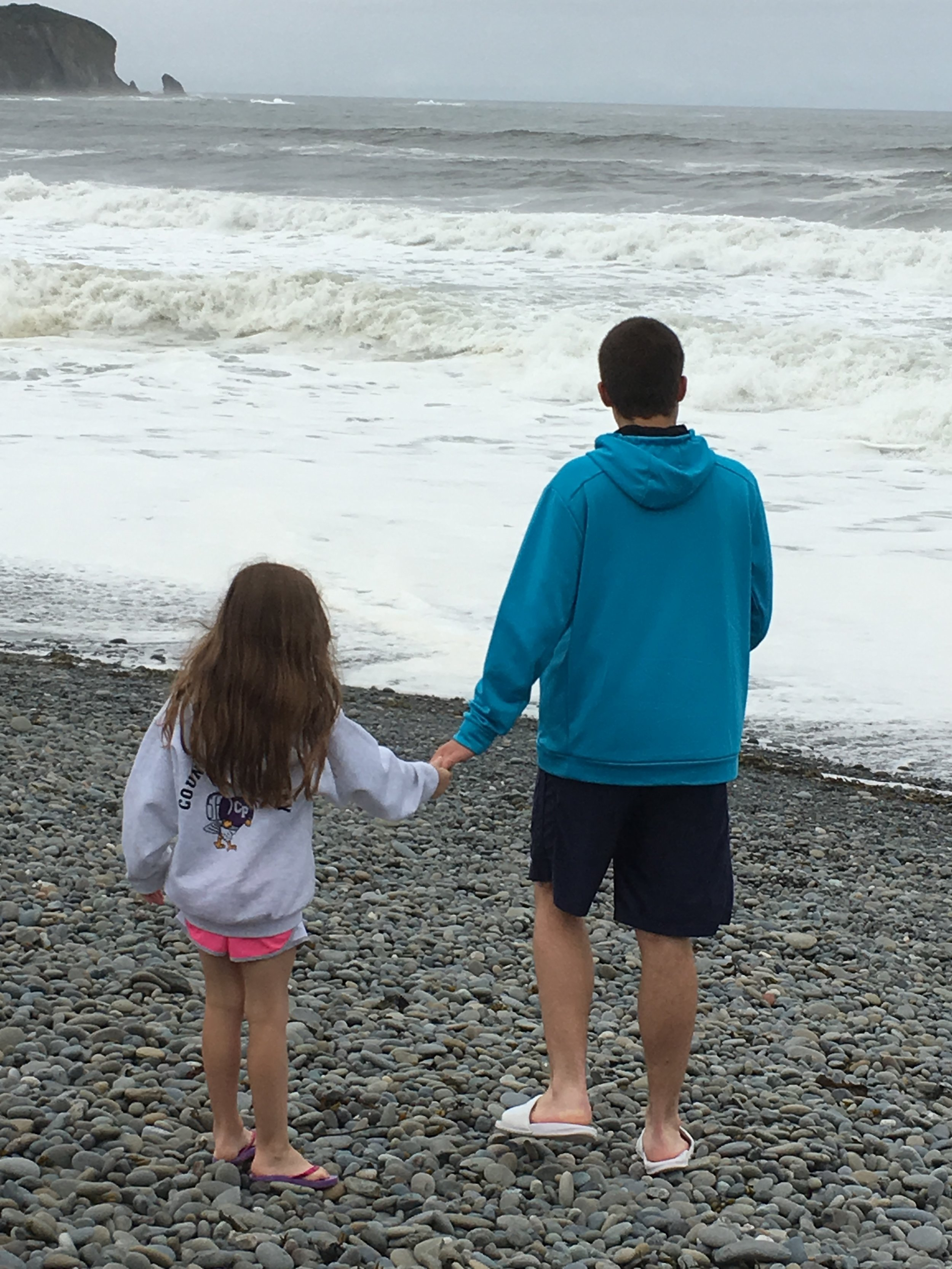 Marcus and his youngest sister Sarah at the beach