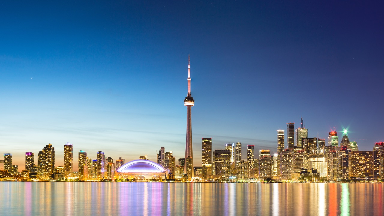 CN TOWER STANDS OUT IN THE TORONTO SKYLINE   Photo Credit: licenced through shutterstock.com