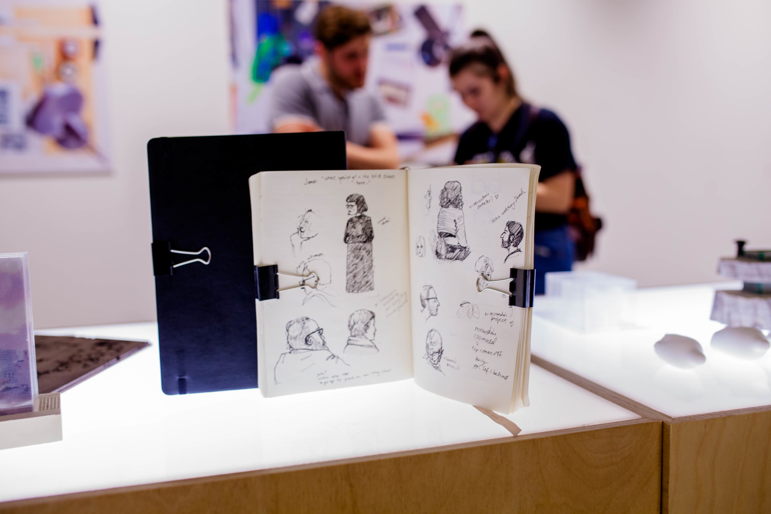 Student sketchbooks on display.