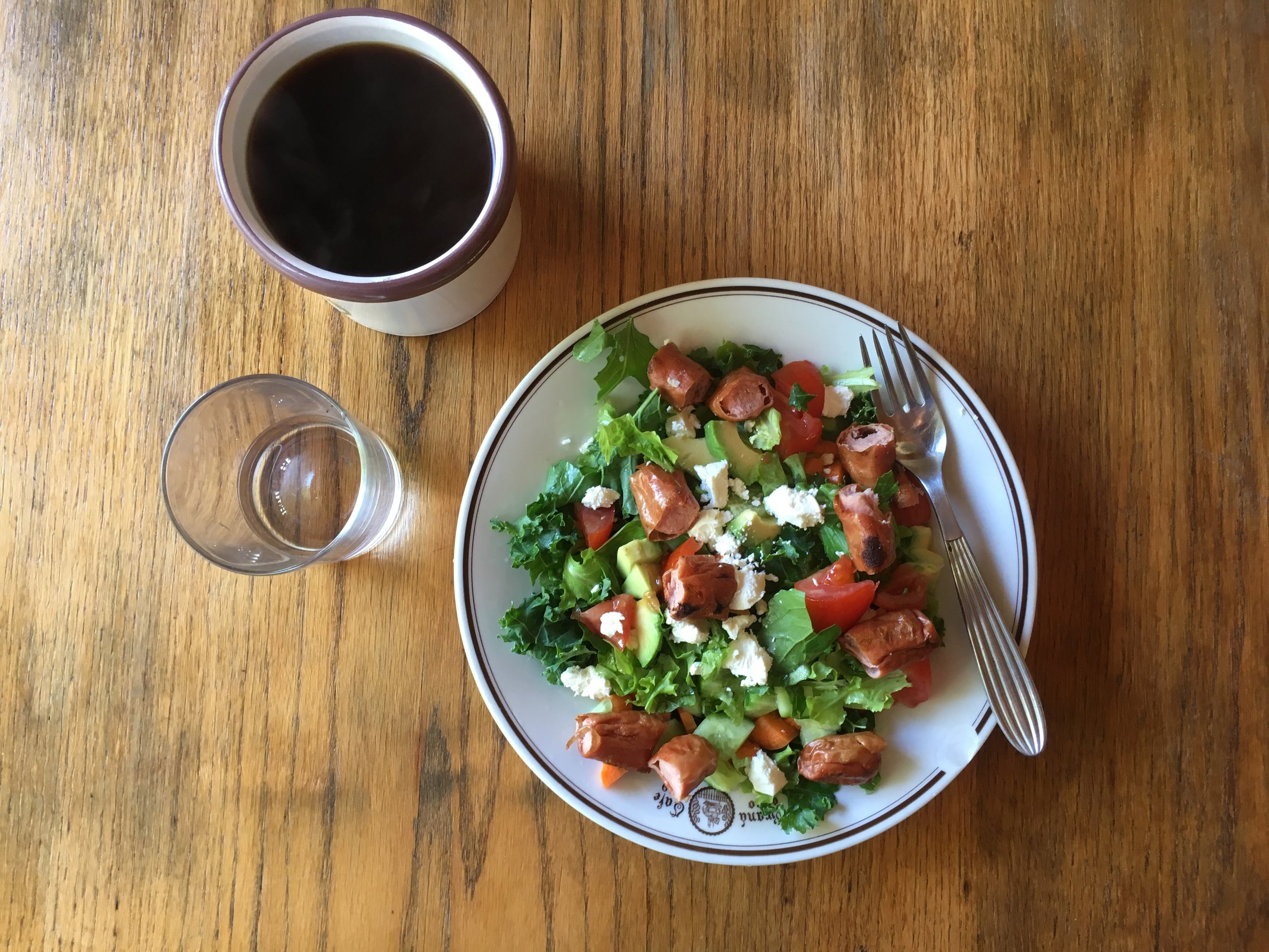 Tuesday Morning breakfast (at noon!): herbs and greens from the garden with chicken sausage, feta cheese, almonds and avocado.