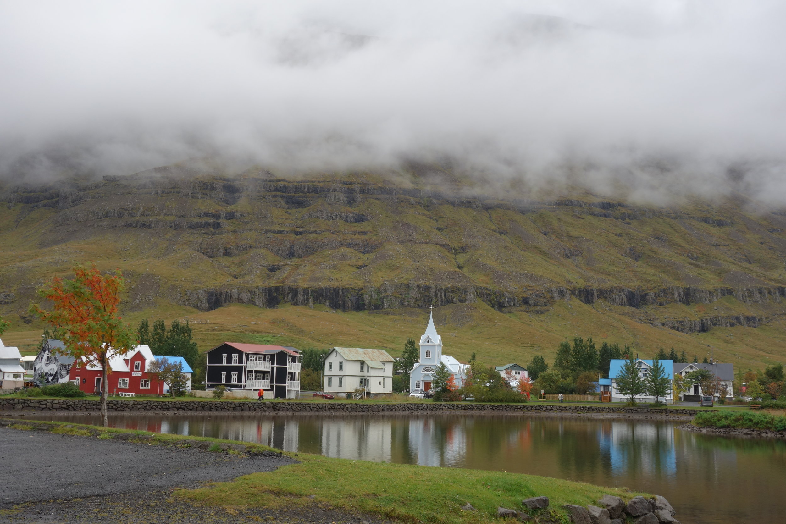 Downtown Seydisfjordur sits fully surrounded by mountains, sometimes I forget how tall they actually are due to the layer of clouds that hovers over us.