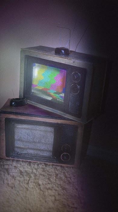 Miniature retro tube TV sets.
